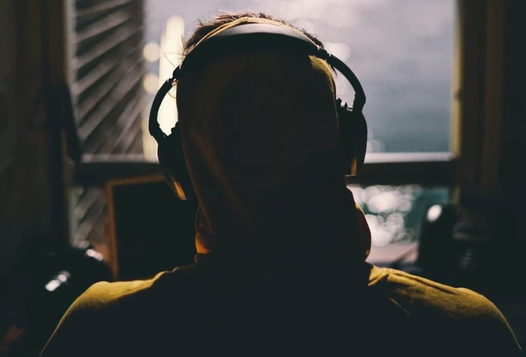 headphone on top of a hoodie
